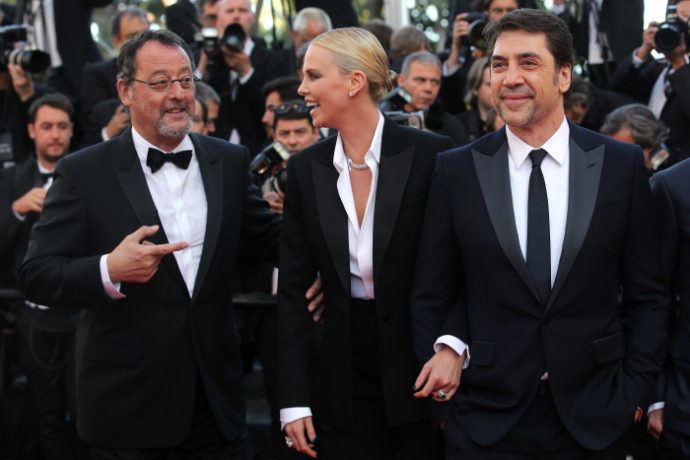 Actors Jean Reno, from lHt, ChaHize Theron and Javier Bardem pose for photographers upon arrival at the screening of the film The Last Face at the 69th international film festival, Cannes, southern France, Friday, May 20, 2016.