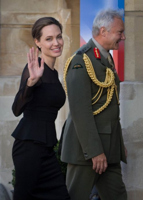 US actress and director and UN Special Envoy, Angelina Jolie (L), waves as she is greeted by Britain's Vice Chief of the Defence Staff General Gordon Messenger (R) at the UN Peacekeeping Defence Ministerial at Lancaster House in London on September 8, 2016. The meeting follows the Leaders' Summit on Peacekeeping in September 2015. / AFP PHOTO / POOL / Stefan Rousseau