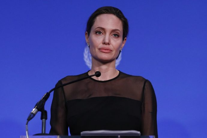 US actress and director and UN Special Envoy, Angelina Jolie, speaks at the UN Peacekeeping Defence Ministerial at Lancaster House in London on September 8, 2016. The meeting follows the Leaders' Summit on Peacekeeping in September 2015. / AFP PHOTO / POOL / Adrian DENNIS
