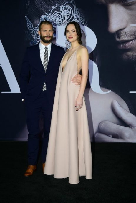 """From the cast, actor Jamie Dorner and actress Dakota Johnson pose on arrival for the premiere of the film """"Fifty Shades Darker"""" in Los Angeles, California on February 2, 2017. / AFP PHOTO / Frederic J. Brown"""
