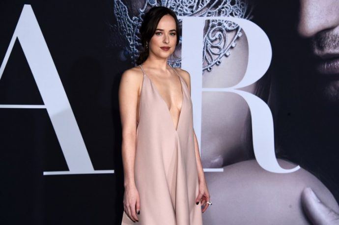 """LOS ANGELES, CA - FEBRUARY 02: Actress Dakota Johnson attends the premiere of Universal Pictures' """"Fifty Shades Darker"""" at The Theatre at Ace Hotel on February 2, 2017 in Los Angeles, California. Alberto E. Rodriguez/Getty Images/AFP"""